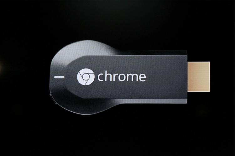 The new Google Chromecast dongle is pictured on an electronic screen as it is announced during a Google event at Dogpatch Studio in San Francisco
